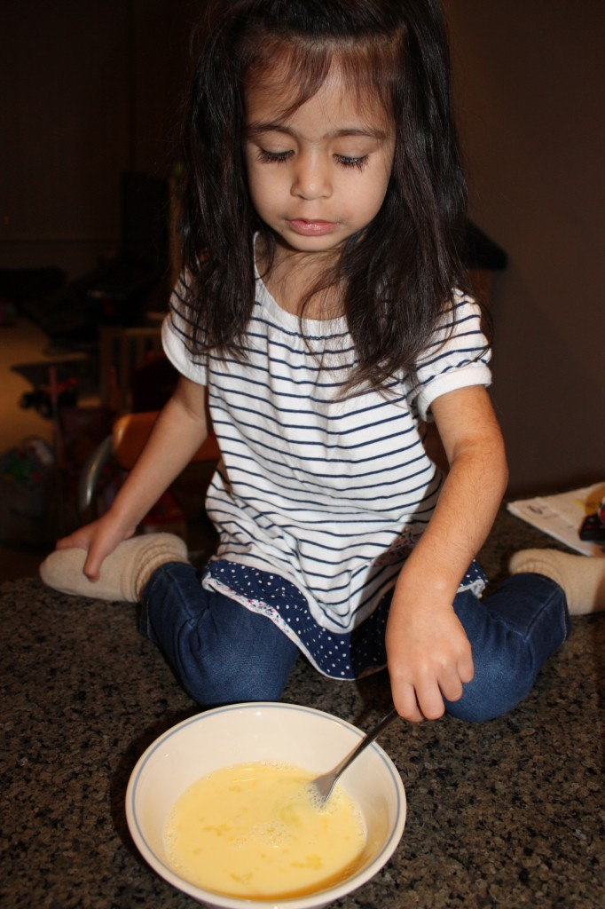 Kyah helping to make French Toast