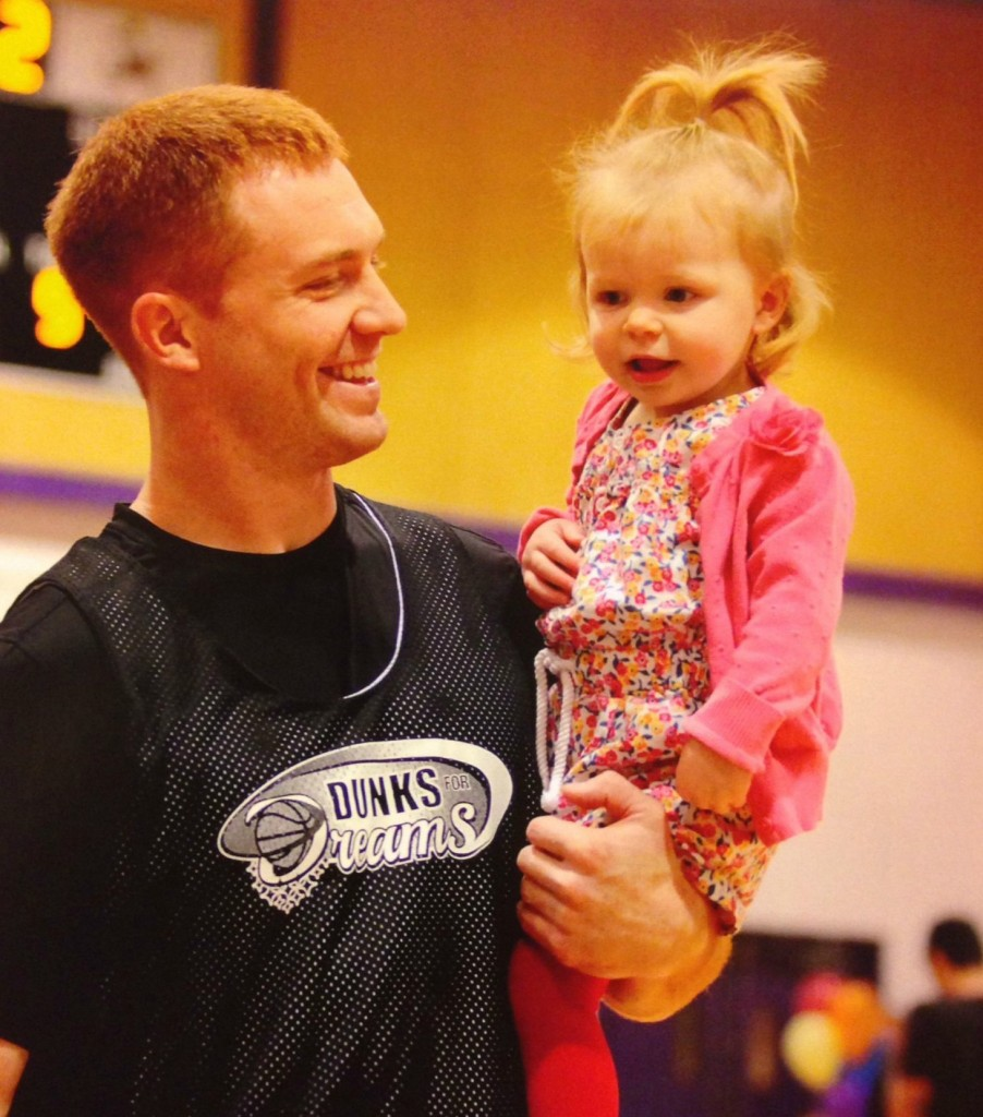 Travis Lulay with daughter