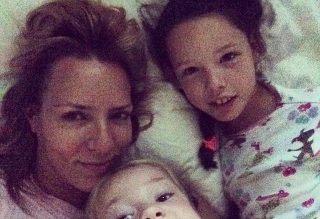 Keri Adams with daughters - in bed