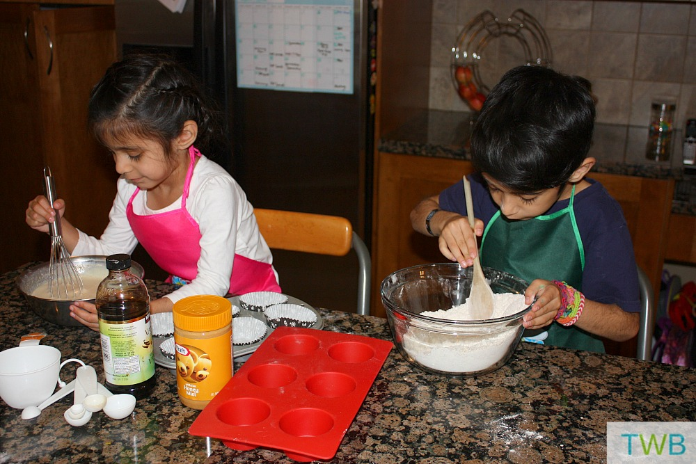 Kids hard at work mixing the wet and dry ingredients