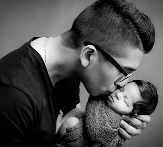 Nabil Karim - with newborn son